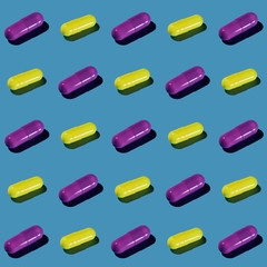 Yellow and Purple Pharma Pill Pattern on Pastel Blue
