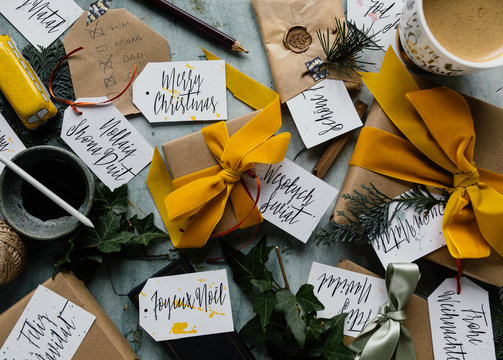 Making a list and writing tags for wrapped christmas presents