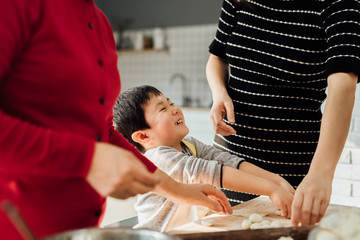 Muti-generation family cooking in kitchen