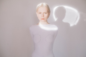 Young model standing in white room