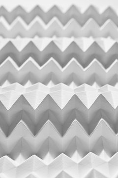 Macro photo of embossed white zigzag paper. Creative layout for background or wallpaper. Top view