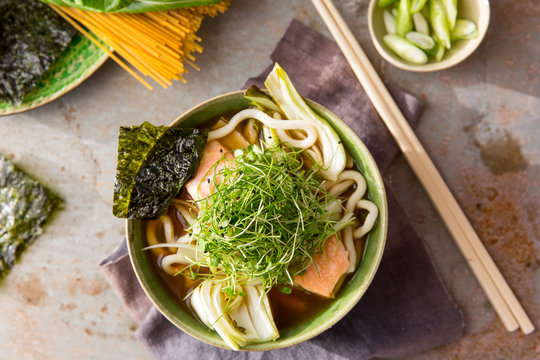 Miso broth with salmon, noodles and micro greens
