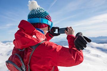 Man taking a photo in winter