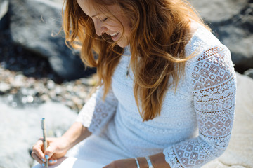 Woman drawing on beach