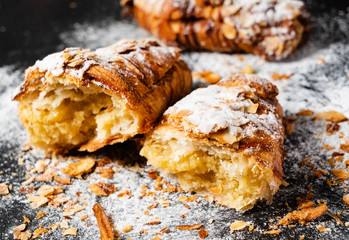 Croissants with almonds on the black background