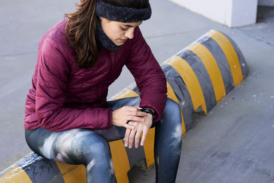 Female runner with smartband watch.
