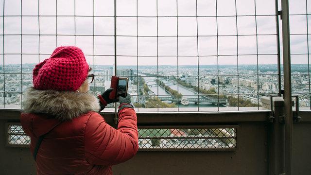Woman visiting Tour Eiffel in Paris, France