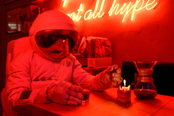 Astronaut celebrating birthday in cafe