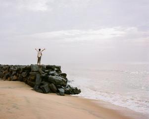 Traveler on ocean enjoying freedom