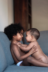 Portrait of beautiful siblings playing at home