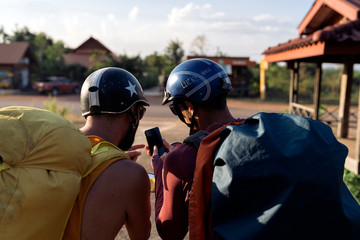 Friends backpackers traveling on motorbike scooter
