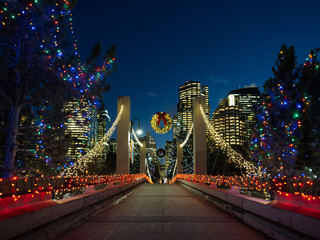 A bridge into a downtown core decorated for Christmas. Fotomurales
