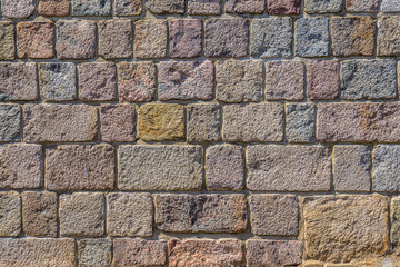 Granit Wand gemauert aus rechteckigen und quadratischen Granitblöcken gemauert