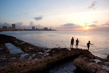 Fishing along the Malecon at sunset in Havana, Cuba