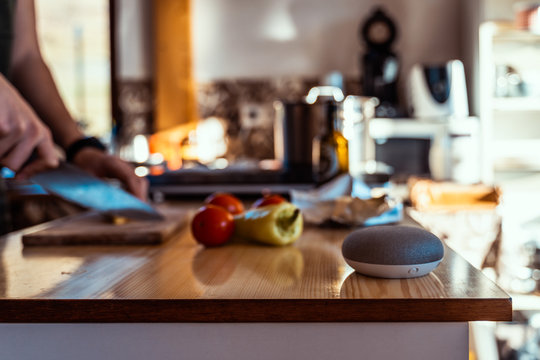Smart ai speaker. Smart home concept with woman cooking in the background