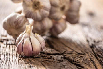 Garlic cloves and bulb old wooden table