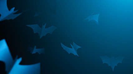 Halloween picture of blue paper bats on blank dark blue background.