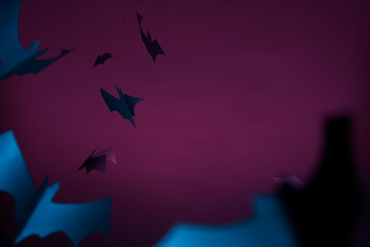 Halloween photo of blue bats on purple background.