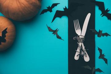 Image of halloween pumpkin, knife, fork, bat