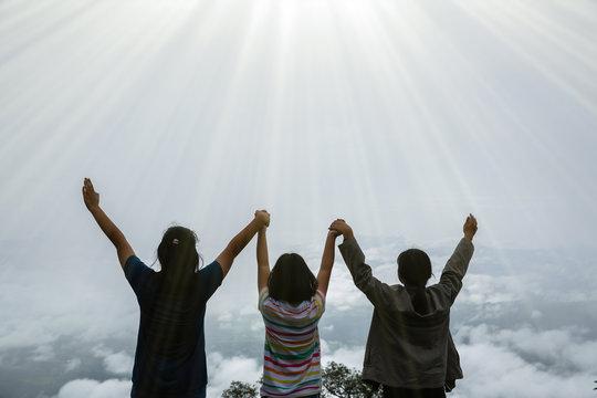 Happy teens deep breath fresh air on top mountain breathing clean air