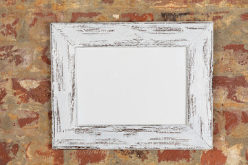 Blank framed picture on a wall