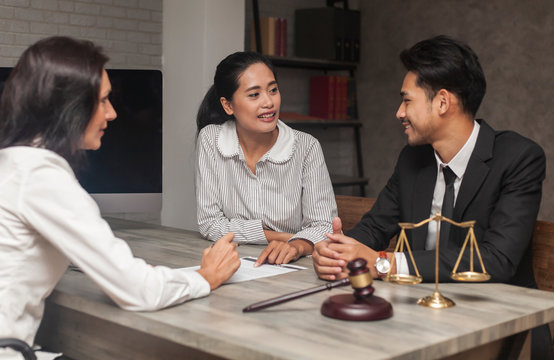 Notary with Client trust team promise winning legal case. lawyer giving consultation to couple for insurance life. Photo of team Lawyer and client discussion and trust Law Firm Justice Attorney Legal