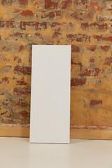Blank canvas and brick wall
