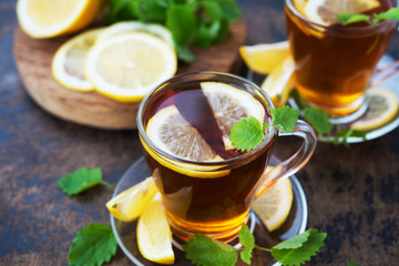 Black hot tea with lemon and mint. Warming autumn revitalizing drink.