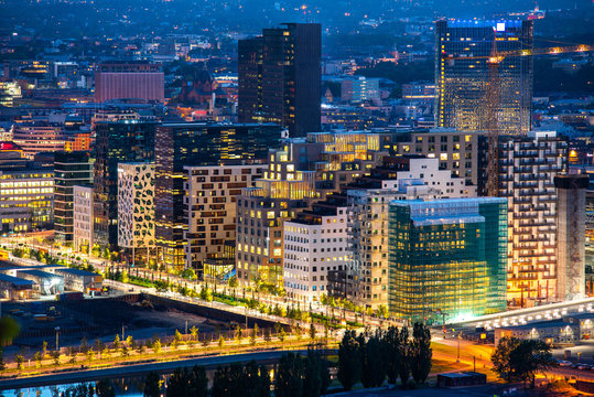 Night view of illuminated street in the Oslo business center. Modern architecture in Norway