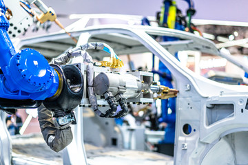 robot arm working in car factory