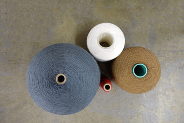 Four Different Spools of Thread Viewed from Above