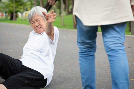Asian elderly people stumbled legs myself or tripped over something,sick senior woman fell to the floor because of dizziness,faint,suffering from illness,headache,hypertension,health care concept