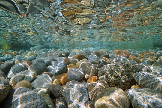 Pebbles stone under water surface natural scene