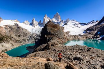 A tourist is admiring Laguna De Los Trek and and Fitz Roy Mountain,  Los Glaciares National Park, Patagonia, Argentina
