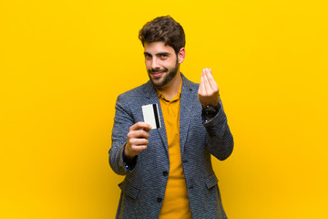young handsome man against orange background