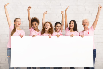 Ladies In Breast Cancer Awareness T-Shirts Holding Blank Board Indoor