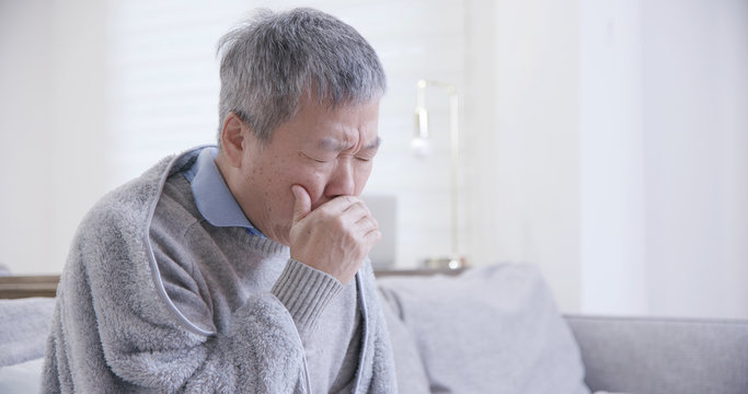 old asian man get a cold