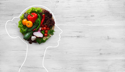 In de dag Keuken Fresh vegetables in woman head symbolizing health nutrition