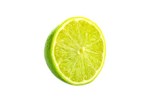 Lime light. Fresh juicy green lemon isolated on white background