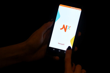 The Naranja X app loads on a cellphone in this illustration picture