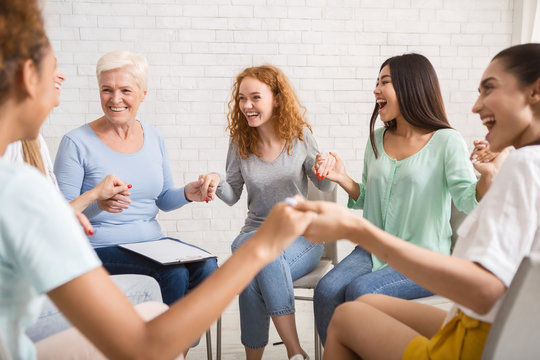 Smiling Diverse Women Sitting In Circle During Group Therapy Indoor