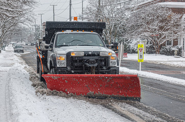 Snowblower Truck cleaning road during the blizzard snow storm