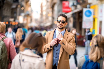 An elegant man walking on the streets