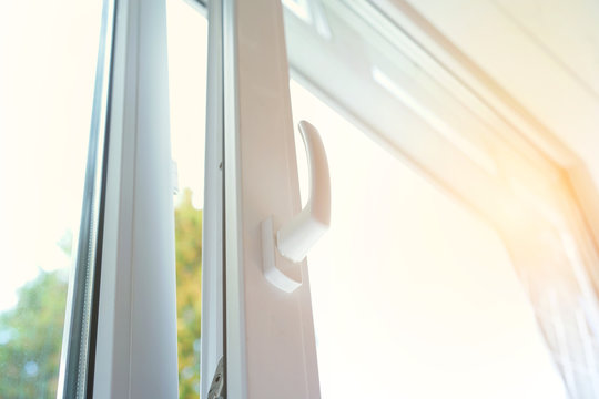 large white plastic open window with handle close-up