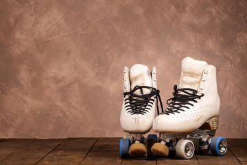 artistic roller skates on a wood background