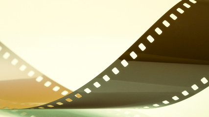 Strip of glossy film abstract close-up
