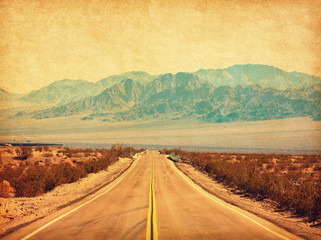 Foto op Plexiglas Route 66 Route 66 crossing the Mojave Desert, California, United States. Photo in retro style. Added paper texture. Toned image