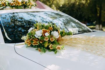 Wedding. Wedding rings on a wedding car. The hood of the car.