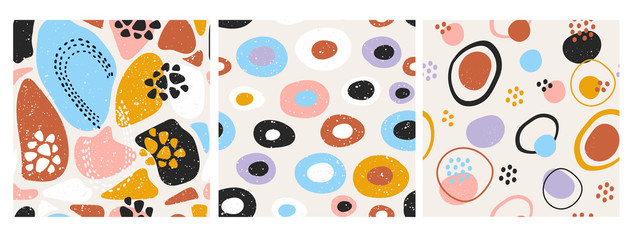 Hand drawn various round and elipse shapes and dots. Doodle objects. Abstract contemporary modern trendy vector illustration. Set of three seamless patterns. Pastel colors. Perfect for textile prints