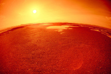 Panoramic view of sand at low tide like mars red planet with red sand and rock.